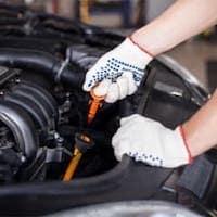 A service technician doing an oil change