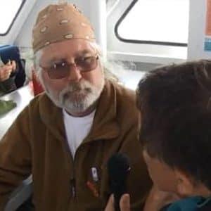 veteran with bandana getting interviewed