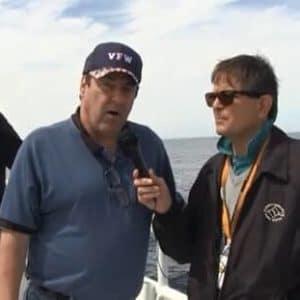 veteran with hat getting interviewed