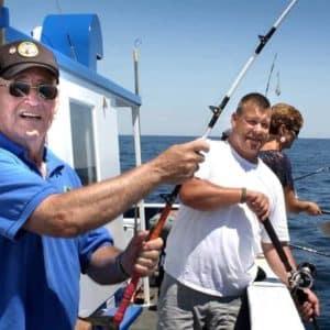 veterans fishing off side of boat