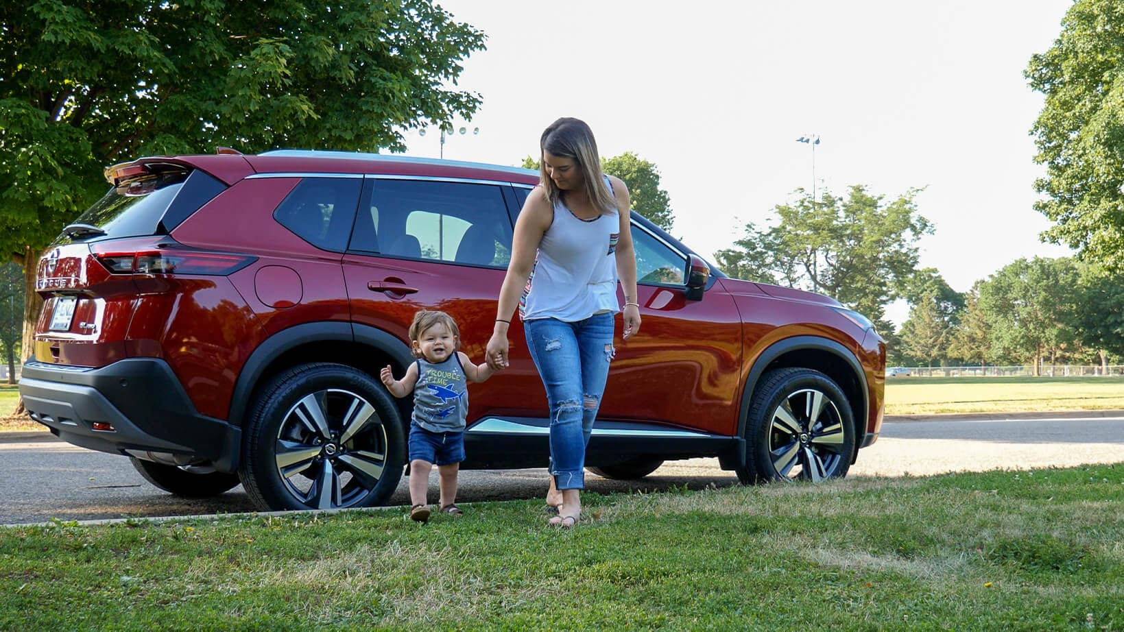mother and son walking from 2021 Nissan Rogue