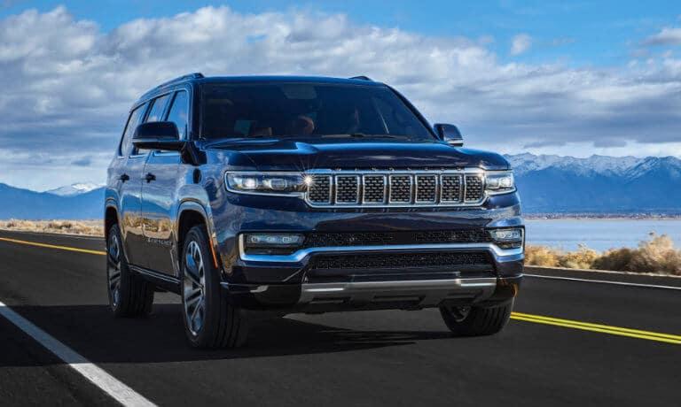 2022 Jeep Grand Wagoneer exterior driving along coastal highway