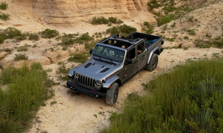2021 Jeep Gladiator exterior driving on rocky terrain