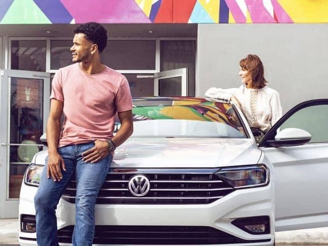 Couple outside their VW car