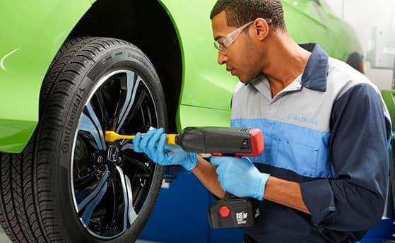 How to check your tires' health at Washington Honda of Washington | Mechanic putting tire on