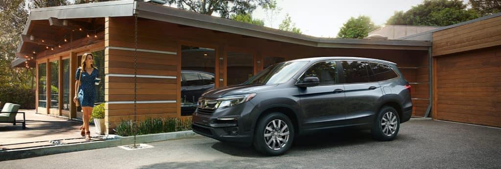 Compare the 2021 Honda Pilot vs. the 2021 Ford Explorer at Washington Honda   Pilot parked outside of home